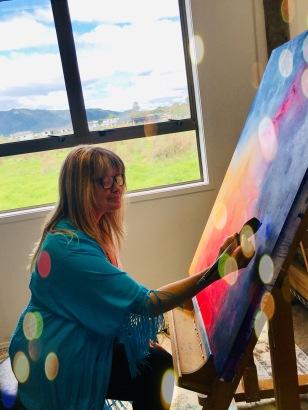 Reina Cottier Artist demonstrating art